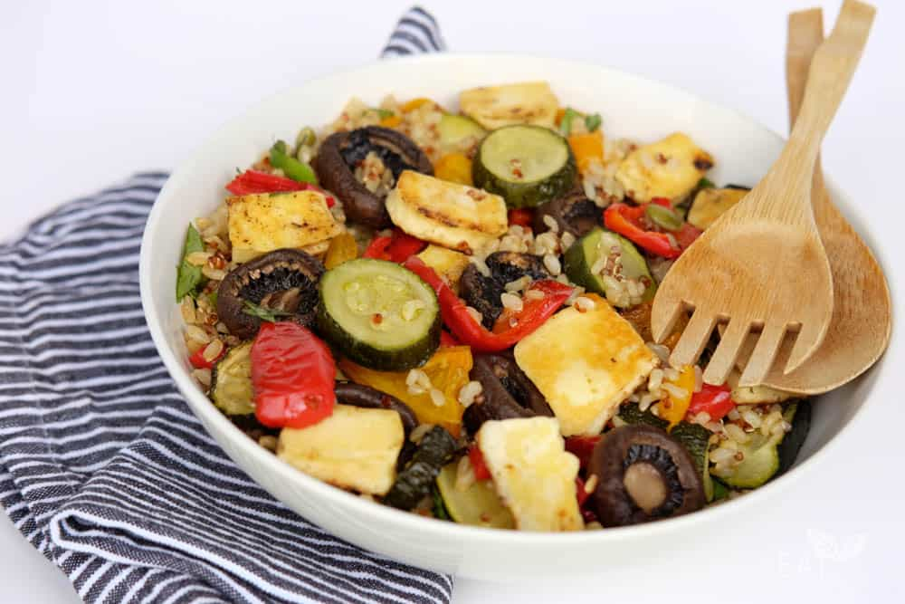 Rice and quinoa salad with halloumi and summer roast vegetables